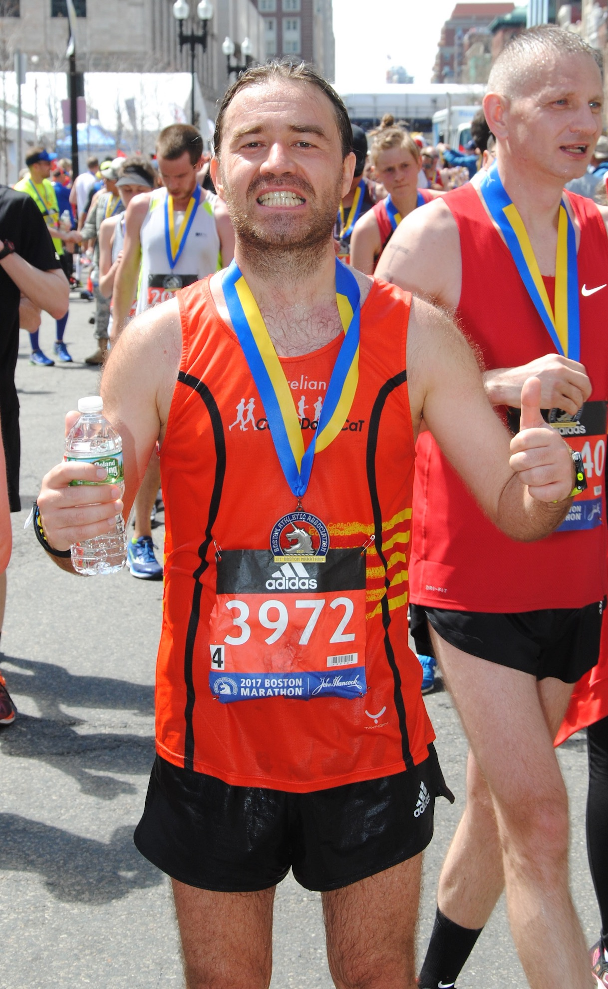 Happy to get the medal<br/>at Boston Marathon finish line 2017